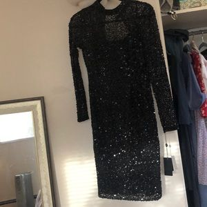 Black sequined Long sleeve dress. Hoco prom